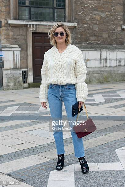 Fashion blogger Adenorah wears a Berenice sweater Levi'u2019s jeans Chanel bag Isabel Marant boots and vintage sunglasses on day 3 during London...