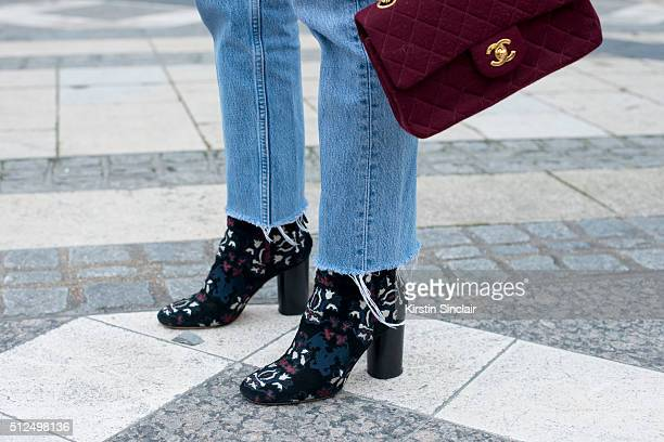 Fashion blogger Adenorah wears Levi'u2019s jeans Chanel bag and Isabel Marant boots on day 3 during London Fashion Week Autumn/Winter 2016/17 on...