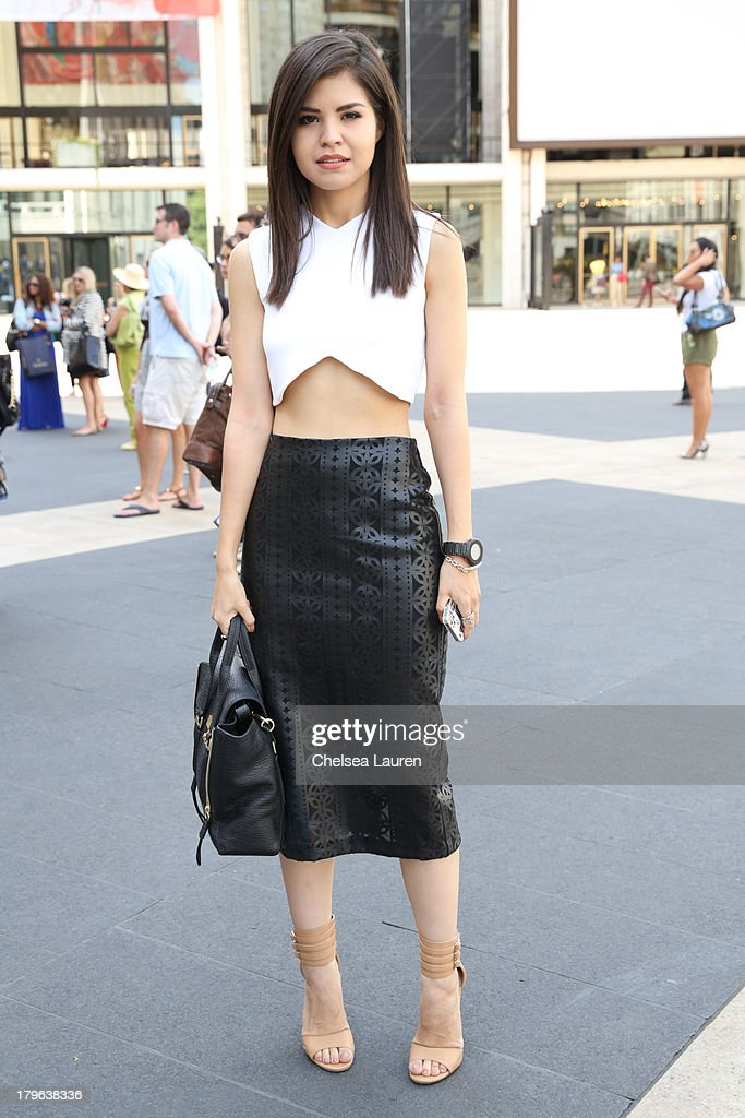 Fashion blogger Adriana Gastelum is seen wearing a ZARA shirt, ASOS skirt and 3.1 Philip Lim purse on the Streets of Manhattan on September 5, 2013 in New York City.