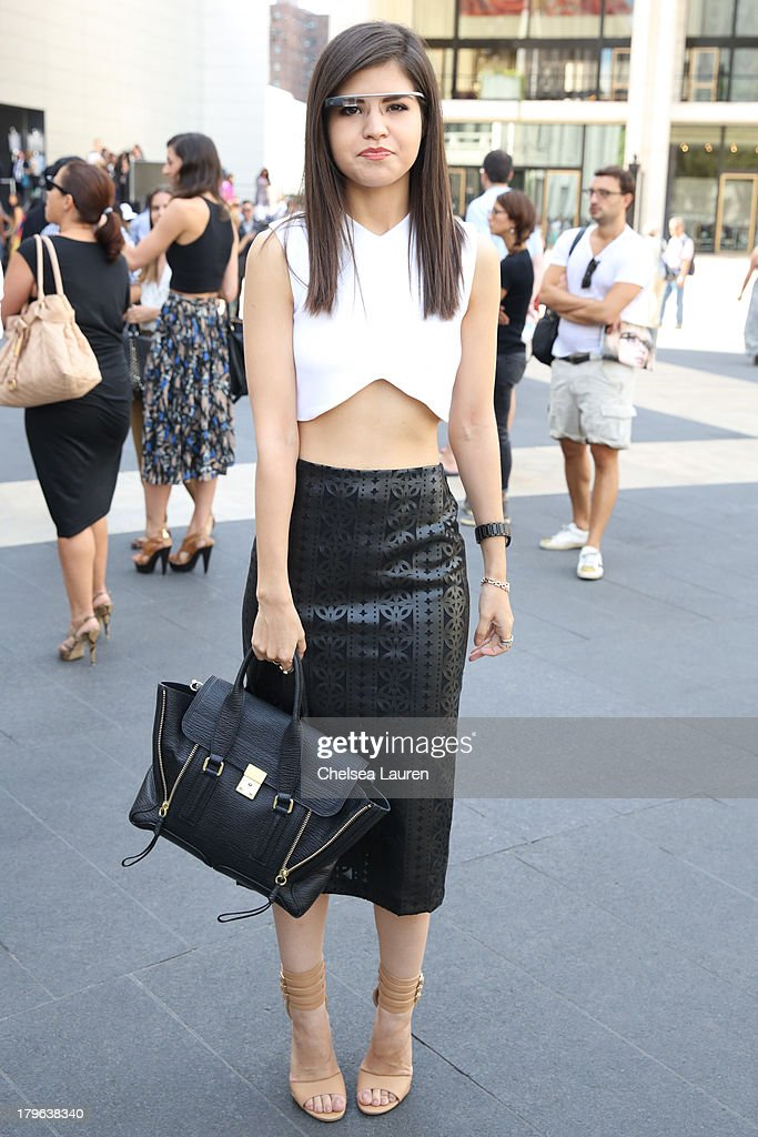 Fashion blogger Adriana Gastelum is seen wearing Google Glass, a ZARA shirt, ASOS skirt and 3.1 Philip Lim purse on the Streets of Manhattan on September 5, 2013 in New York City.