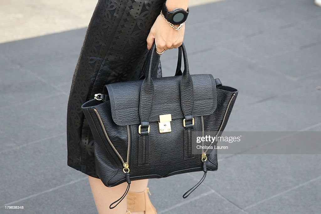 Fashion blogger Adriana Gastelum is seen with a 3.1 Philip Lim purse on the Streets of Manhattan on September 5, 2013 in New York City.