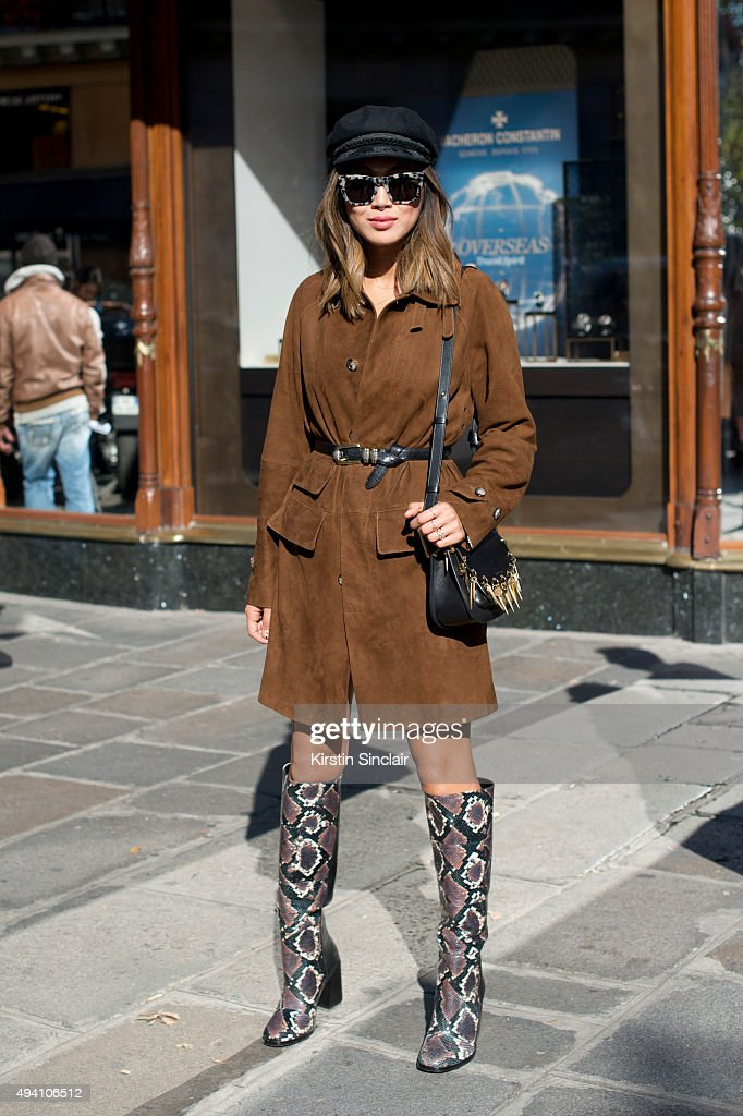 Fashion Blogger Aimee Song wears a Carven coat Aska shoes and a Chloe bag with Fashion Blogger Irene Kim on day 3 during Paris Fashion Week...