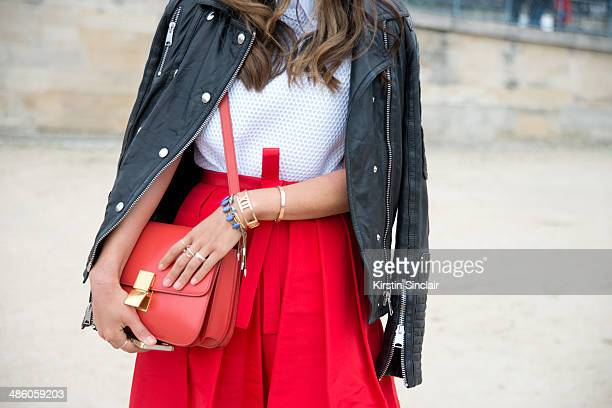 Fashion Blogger Aimee Song wears a Celine bag Anine Bing coat Tibi skirt Viktor and Rolf top on day 5 of Paris Collections Women on March 01 2014 in...