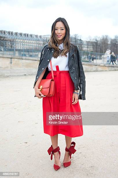 Fashion Blogger Aimee Song wears a Celine bag Anine Bing coat Tibi skirt Viktor and Rolf top and Aminah Abdul Jillil shoes on day 5 of Paris...