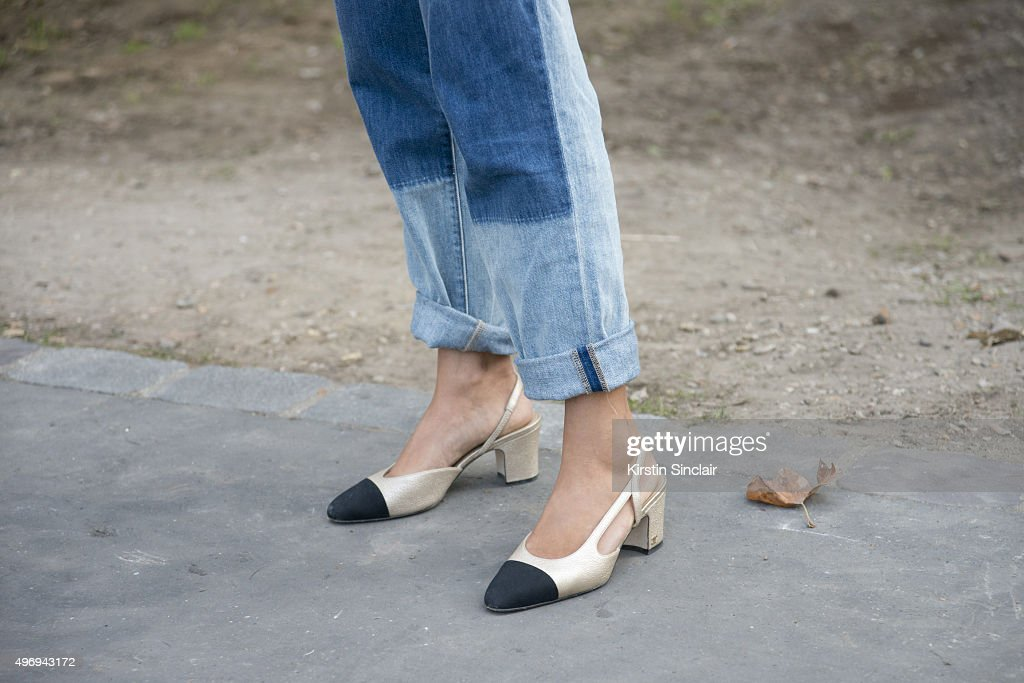 Fashion Blogger Aimee Song wears a Chanel top bag and shoes and Wild Fox jeans on day 6 during Paris Fashion Week Spring/Summer 2016/17 on October 4...