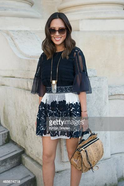 Fashion blogger Aimee Song wears a Chloe dress and bag at the Chloe show on day 6 of Paris Collections Women on March 08 2015 in Paris France