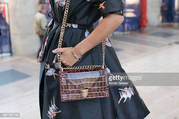 Fashion Blogger Aimee Song wears a Rochas dress and Dior bag on day 2 during Paris Fashion Week Spring/Summer 2016/17 on September 30 2015 in London...
