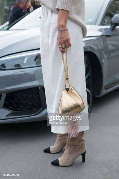 Fashion blogger Aimee Song wears Chanel boots The Volvon bag and Tibi trousers day 2 of Paris Womens Fashion Week Spring/Summer 2018 on September 27...