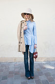 Fashion blogger Alina Gelzane wears HM hat and shirt Burberry trench coat Prada shoes and vintage bag on day 3 of Paris Collections Women on March 05...