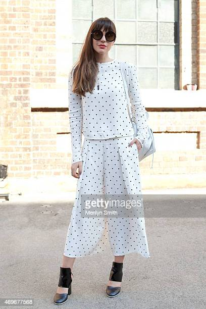 Fashion Blogger Ally Carey wears a Bec and Bridge top and trousers Beau coops shoes Sunday Somewhere sunglasses and Samantha Wills accessories at...