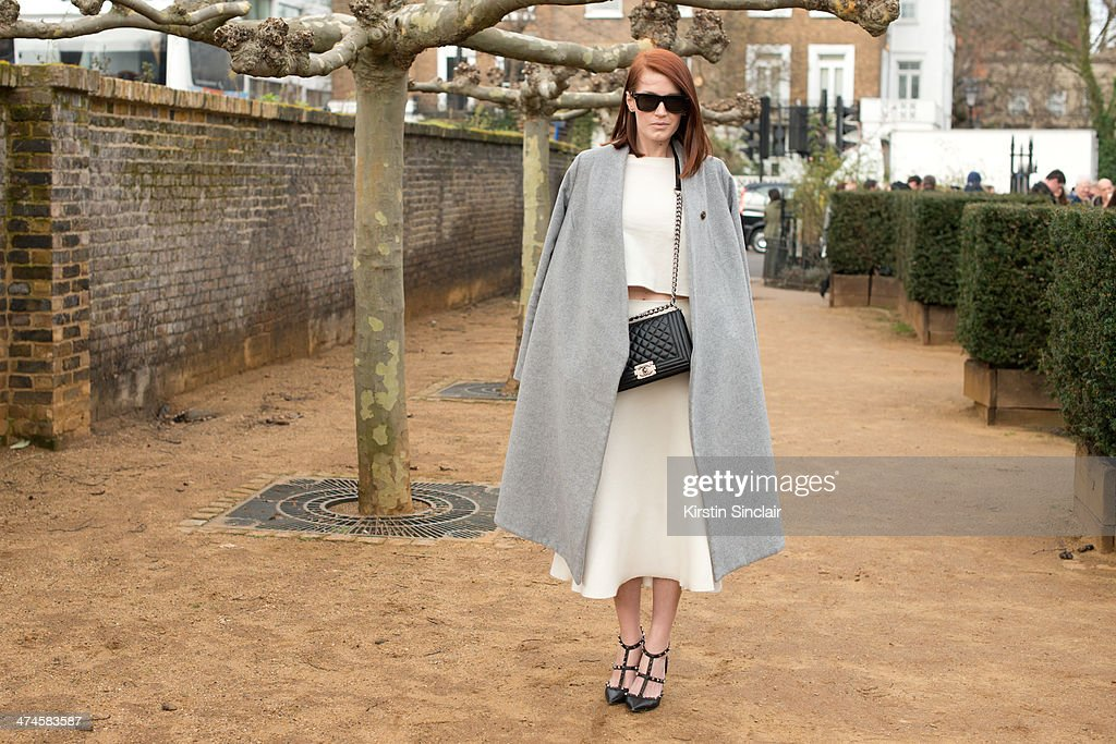 Fashion Blogger Amber Venz wears a Chanel bag, Celine sunglasses, Wayne jacket, Zara top and skirt and Valentino shoes on day 4 of London Collections: Women on February 17, 2014 in London, England.