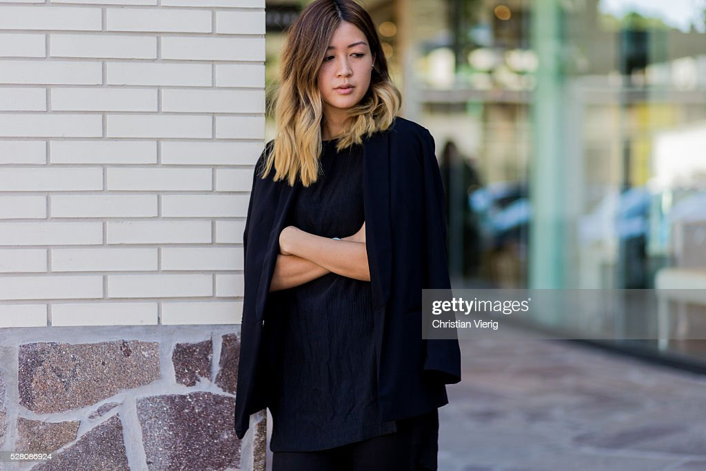 Fashion blogger and Digital Marketing Strategist Nora Chan is wearing a black Topshop blazer, a oversized black Third Form top, black skinny Forever New denim jeans on May 4, 2016 in Brisbane, Australia.