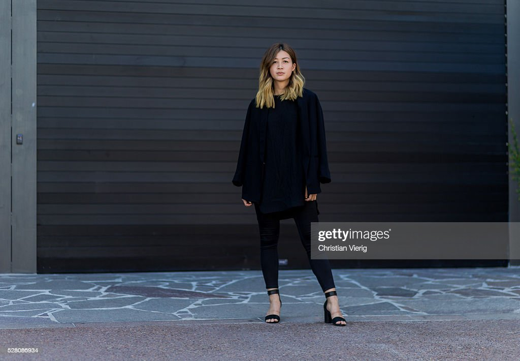 Fashion blogger and Digital Marketing Strategist Nora Chan is wearing a black Topshop blazer, a oversized black Third Form top, black skinny Forever New denim jeans, black Topshop heel sandals as shoes on May 4, 2016 in Brisbane, Australia.