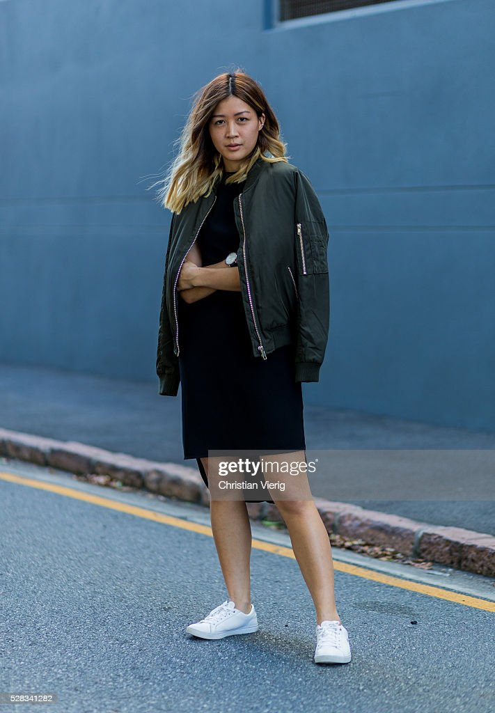 Fashion blogger and Digital Marketing Strategist Nora Chan wearing an olive green Topshop bomber jacket, a black Topshop dress and white Lacoste sneakers on May 4, 2016 in Brisbane, Australia.