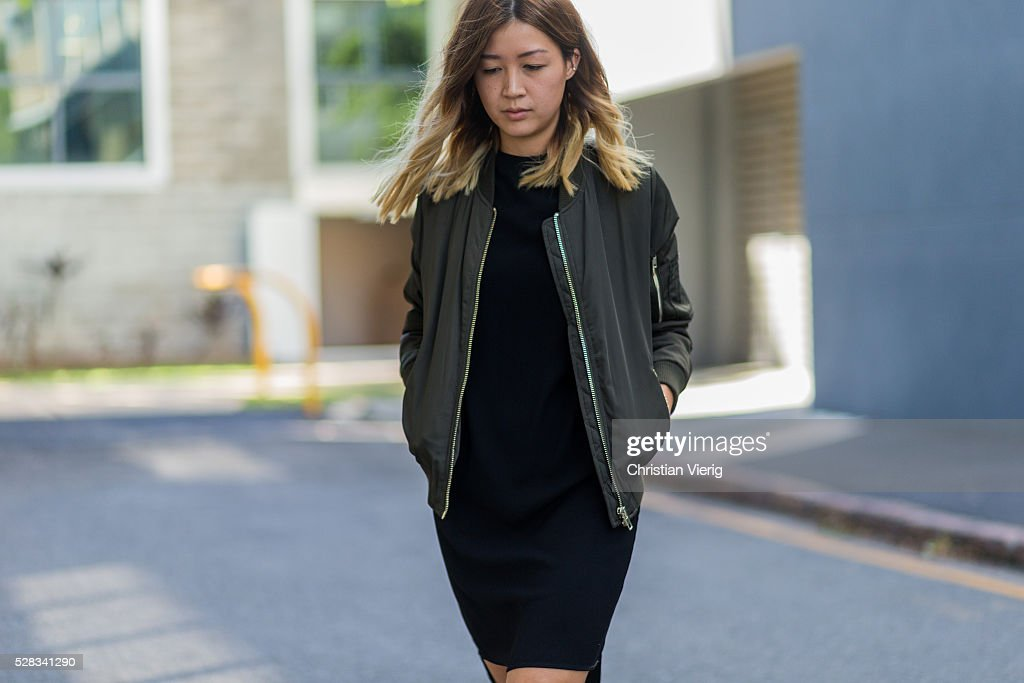 Fashion blogger and Digital Marketing Strategist Nora Chan wearing an olive green Topshop bomber jacket, a black Topshop dress on May 4, 2016 in Brisbane, Australia.