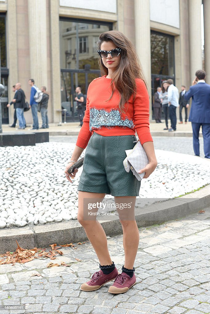 Fashion blogger and DJ Bip Ling wearing a Carven top and shorts, Prada shoes, Louis Vuitton bag and Miu Miu sunglasses on day 9 of Paris Fashion Week Spring/Summer 2014, Paris October 02, 2013 in Paris, France.