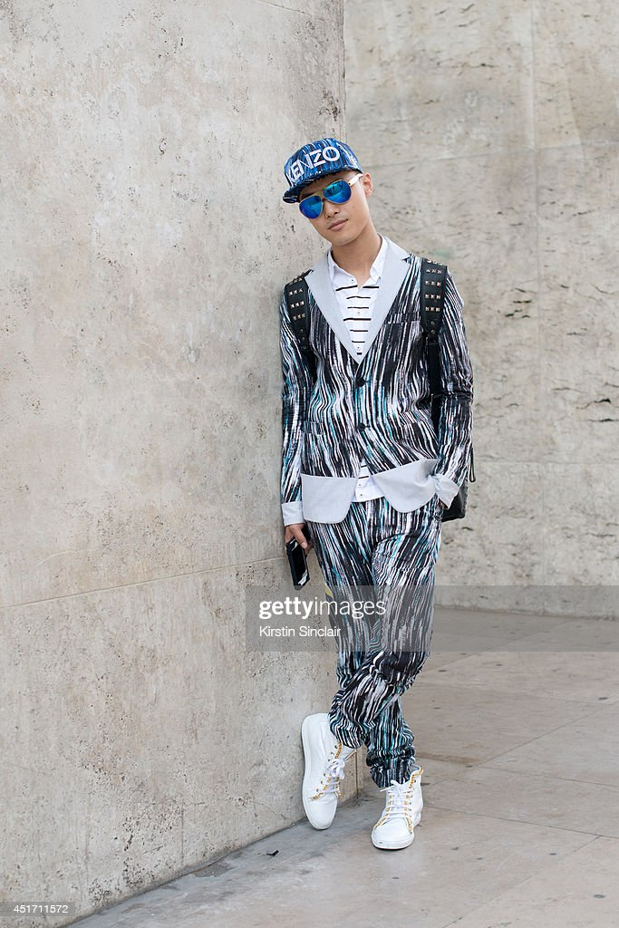 Fashion blogger and DJ Peter Xu wearing a Kenzo, jacket and trousers, Louis Leeman trainers, Mykita sunglasses and Dsquared2 shirt on day 3 of Paris Collections: Men on JUNE 27, 2014 in Paris, France.