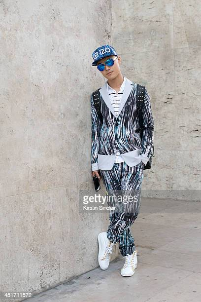 Fashion blogger and DJ Peter Xu wearing a Kenzo jacket and trousers Louis Leeman trainers Mykita sunglasses and Dsquared2 shirt on day 3 of Paris...