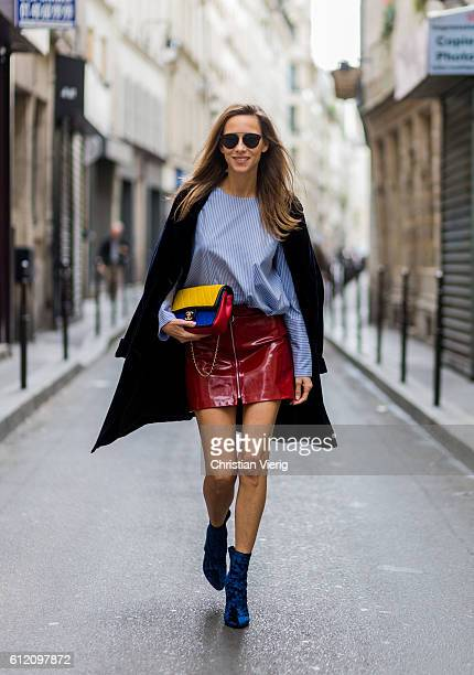 Fashion blogger and model Alexandra Lapp wearing a red skirt and button shirt from Zara blue Phillip Lim shoes Steffen Schraut black coat and Gucci...