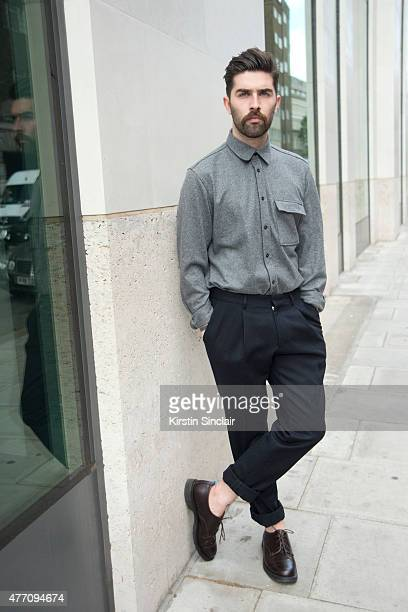 Fashion blogger and model Chris Millington wears all Jigsaw on day 2 of London Collections Men on June 13 2015 in London England