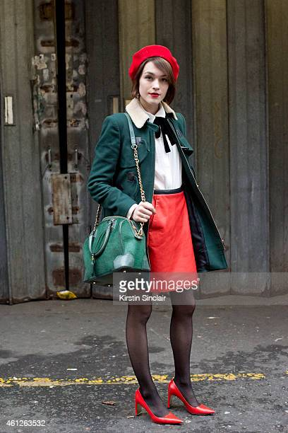Fashion blogger and model Ella Catliff wearing The Gallic Rusto beret Coach skirt and shoes Whistles coat Alice and Olivia bag and a Maje top on day...