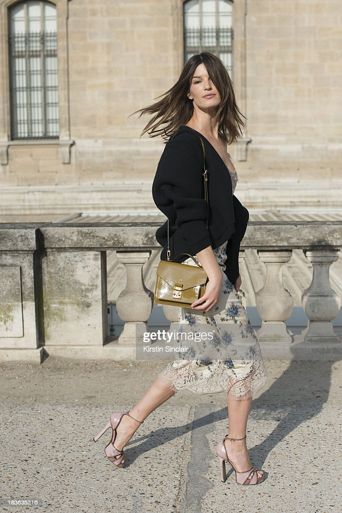 Fashion blogger and model Hanneli Mustaparta wearing Louis Vuitton with a Calvin Klein cardigan on day 9 of Paris Fashion Week Spring/Summer 2014, Paris October 02, 2013 in Paris, France.