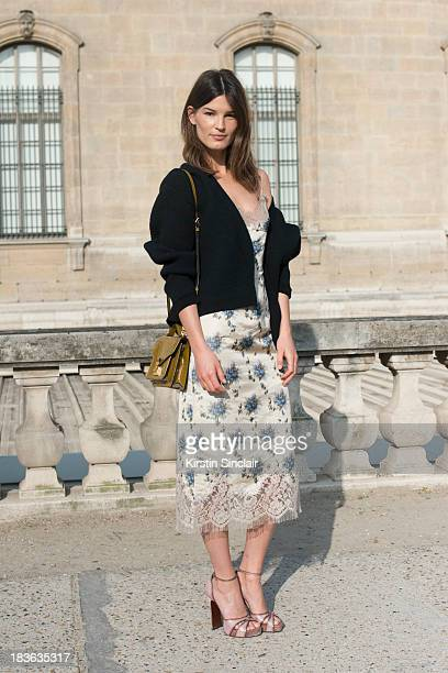 Fashion blogger and model Hanneli Mustaparta wearing Louis Vuitton with a Calvin Klein cardigan on day 9 of Paris Fashion Week Spring/Summer 2014...