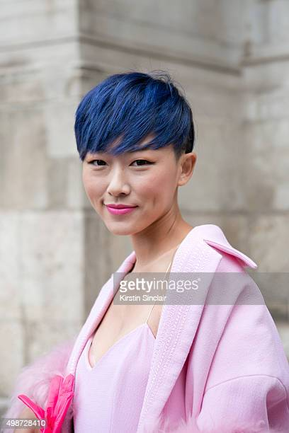 Fashion blogger and Model Liuxi Liu wears a Pascal Miller jacket and top on day 7 during Paris Fashion Week Spring/Summer 2016/17 on October 5 2015...