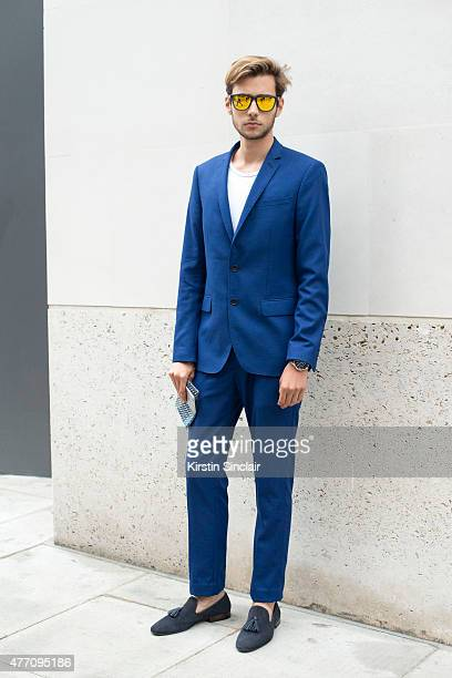Fashion blogger and model Ruben Ramos wears Hawkers sunglasses Zara suit and shoes and Ralph Lauren T shirt on day 2 of London Collections Men on...