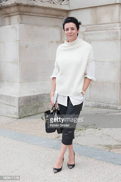 Fashion blogger and photographer Garance Dore wears a Rick Owens knit Zara trousers Equipment blouse Phillip Lim bag and Jimmy Choo shoes on day 8 of...