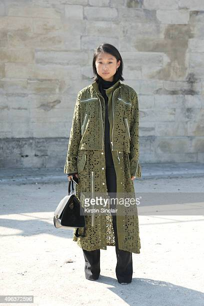 Fashion Blogger and Photographer Margaret Zhang wears an Ellie Saab top Celine bag Asilio jacket and Givenchy shoes on day 5 during Paris Fashion...