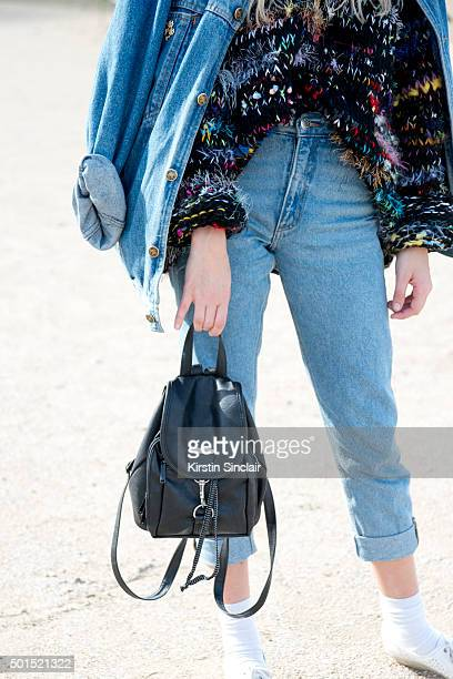 Fashion Blogger and Photographer Marie My wears a vintage bag shoes and jacket Monki jeans and Larke Bagger sweater on day 8 during Paris Fashion...