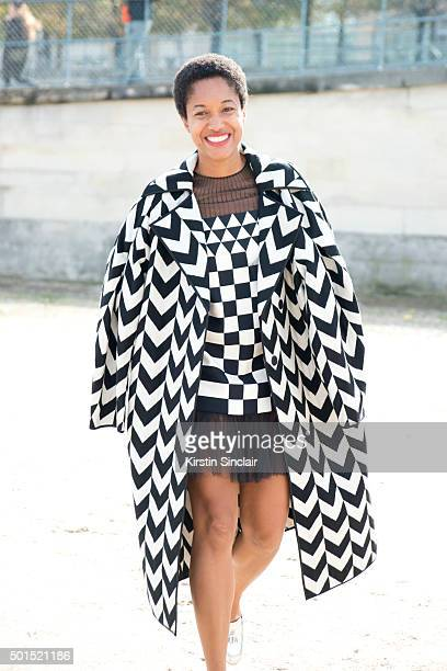 Fashion Blogger and Photographer Tamu McPherson wears a Miss Min coat and Valentino dress on day 8 during Paris Fashion Week Spring/Summer 2016/17 on...