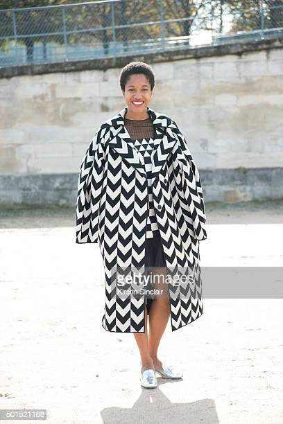 Fashion Blogger and Photographer Tamu McPherson wears a Miss Min coat Saint Laurent shoes and Valentino dress on day 8 during Paris Fashion Week...