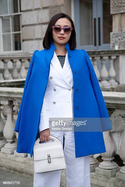 Fashion blogger and student Chelsea Cui wears a Stella McCartney coat Joseph suit Thierry Lasry sunglasses Balenciaga bag on February 24 2015 in...
