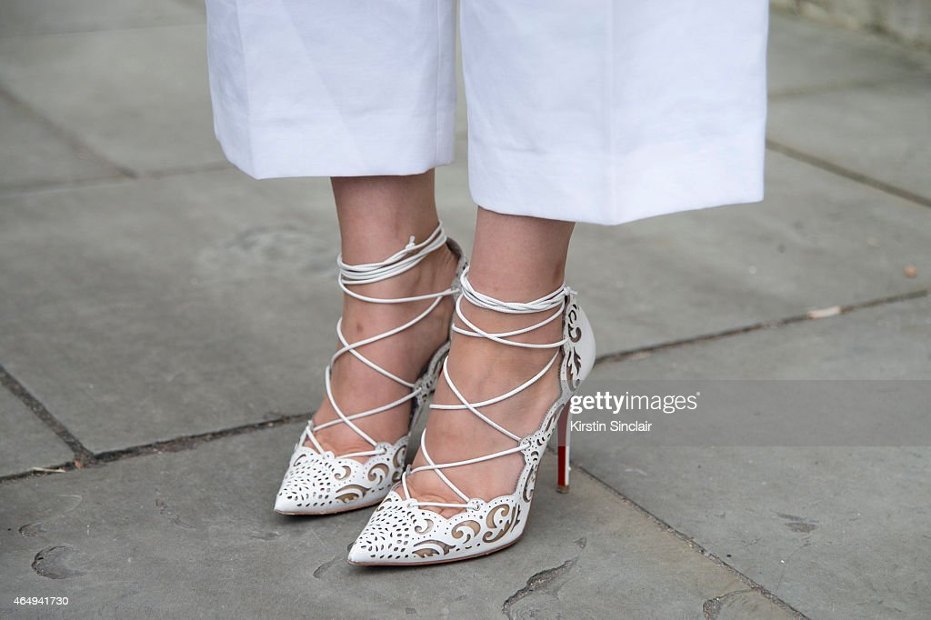Fashion blogger and student Chelsea Cui wears Joseph suit Christian Louboutin shoes on February 24 2015 in London England