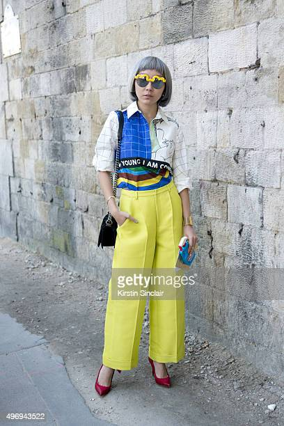 Fashion Blogger and Stylist Crystal Gao wears a Chictopia top Le Specs sunglasses Malone shoes and Moschino iPhone case on day 6 during Paris Fashion...