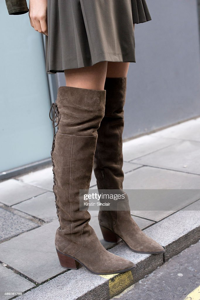 Fashion blogger and stylist Doina Ciobanu wears Aldo boots and Versus Versace skirt on day 2 during London Fashion Week Spring/Summer 2016/17 on...