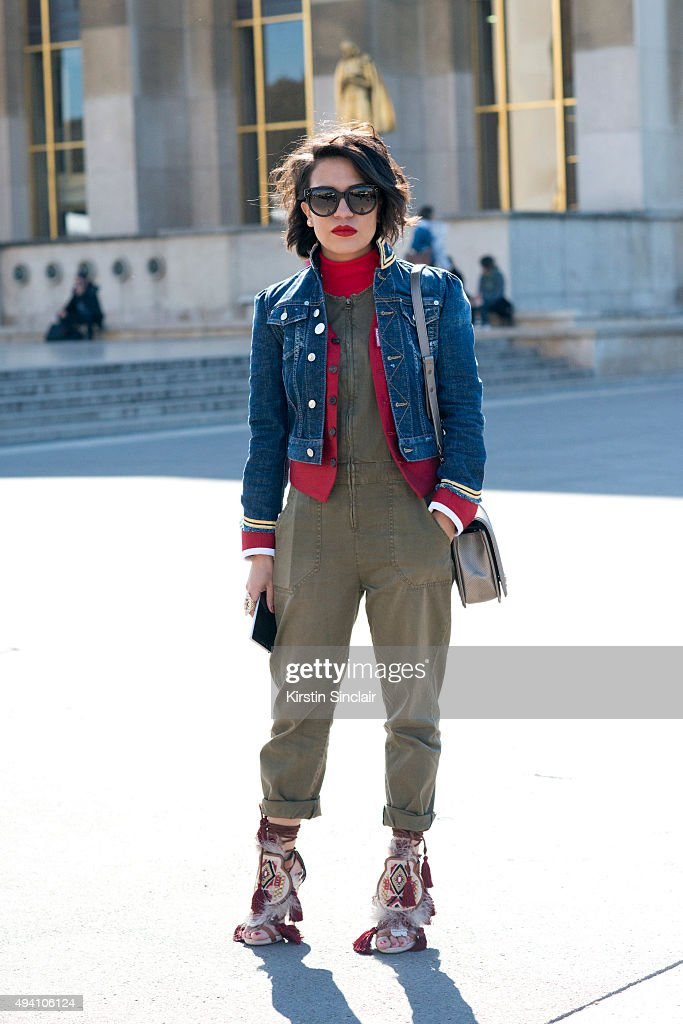 Fashion Blogger and Stylist Gina Ortega wears a Dsquared jacket and shoes Current Elliott jumpsuit Chanel bag and Celine sunglasses on day 3 during...