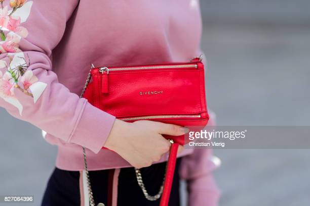 Fashion blogger and stylist Maria Barteczko wearing pink Off White sweater a red Givenchy bag glasses HM jogger pants on August 6 2017 in Duesseldorf...