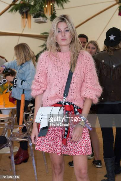 Fashion blogger and writer Camille Charriere wears a Ganni jumper Kappa tracksuit top at the Veuve Clicquot Champagne Bar Wilderness Festival on...