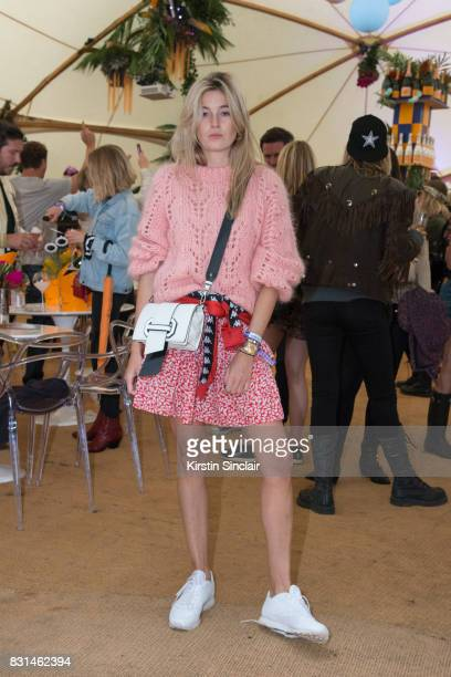 Fashion blogger and writer Camille Charriere wears a Ganni jumper Kappa tracksuit top Reebok trainers at the Veuve Clicquot Champagne Bar Wilderness...