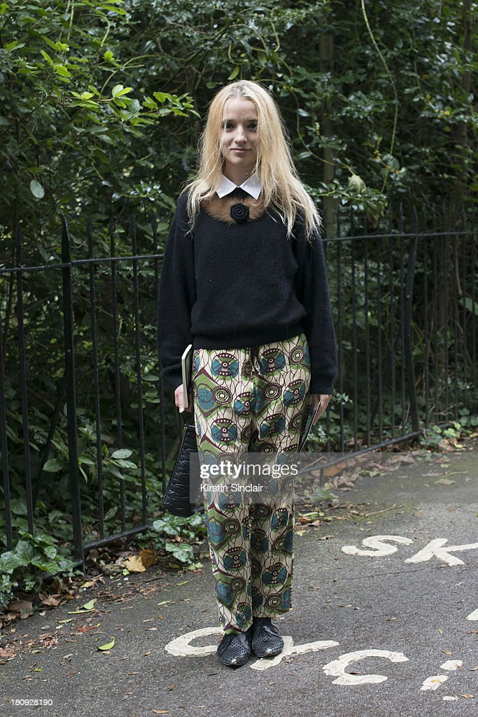 Fashion Blogger and Writer Silvia Bombardini wears Mari for H and M trousers, NCQ shoes, vintage sweater and a Topman shirt on day 5 of London Fashion Week Spring/Summer 2013, at Somerset House on September 17, 2013 in London, England.