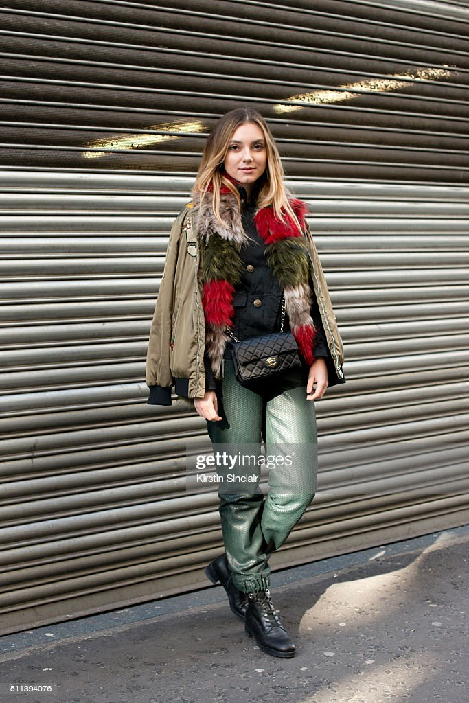 Fashion blogger Andrea Cristea wears an Izaak Azanei scarf, Amanda Wakeley jeans, Zara bomber, Vintage jacket, and Chanel bag on day 1 during London Fashion Week Autumn/Winter 2016/17 on February 19, 2016 in London, England.