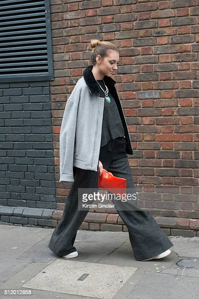 Fashion blogger Andreea Cristea wears all Amanda Wakeley and an Aspinal Of London bag on day 5 during London Fashion Week Autumn/Winter 2016/17 on...