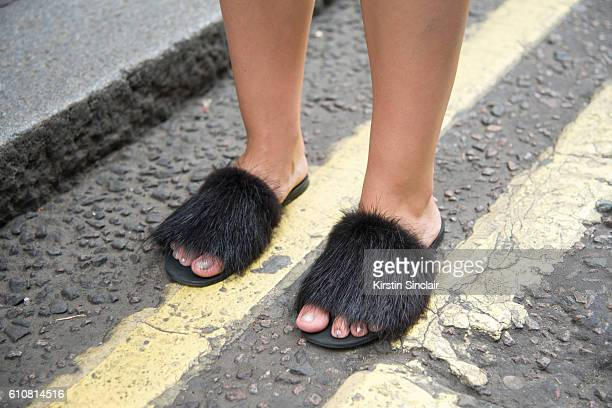 Fashion blogger Andreea Cristea wears custom made shoes on day 5 of London Womens Fashion Week Spring/Summer 2016 on September 20 2016 in London...