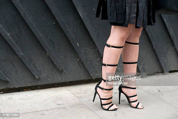 Fashion Blogger Andreea Cristea wears Pinghe Pinghe dress Prada bag and River Island shoes on day 1 of London Collections Men on June 12 2015 in...