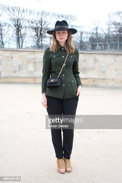 Fashion Blogger Angelica Ardasheva wears a Borsalino hat vintage Versace coat Mango trousers Dolce and Gabbana bag and Gianvito Rossi shoes on day 5...