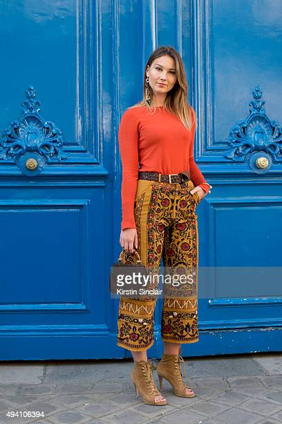 Fashion Blogger Angelica Ardasheva wears Zara trousers and top Buti bag Gianvito Rossi shoes and Medium Salad jewellery on day 3 during Paris Fashion...