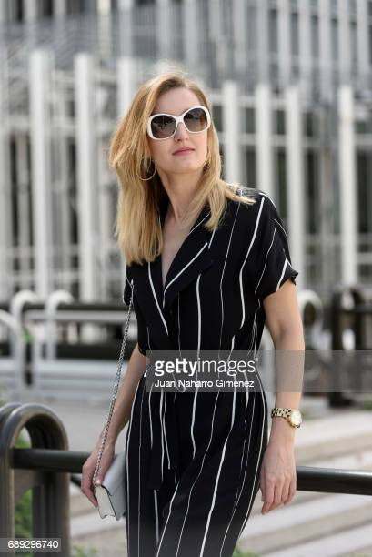 Fashion blogger Anna Nazarova is wearing Mango shoes Selected Femme dress Michael Kors hangbag Prada glases and Mango whatch and earrings on May 28...